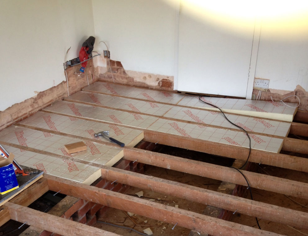 Laying insulation between the joists